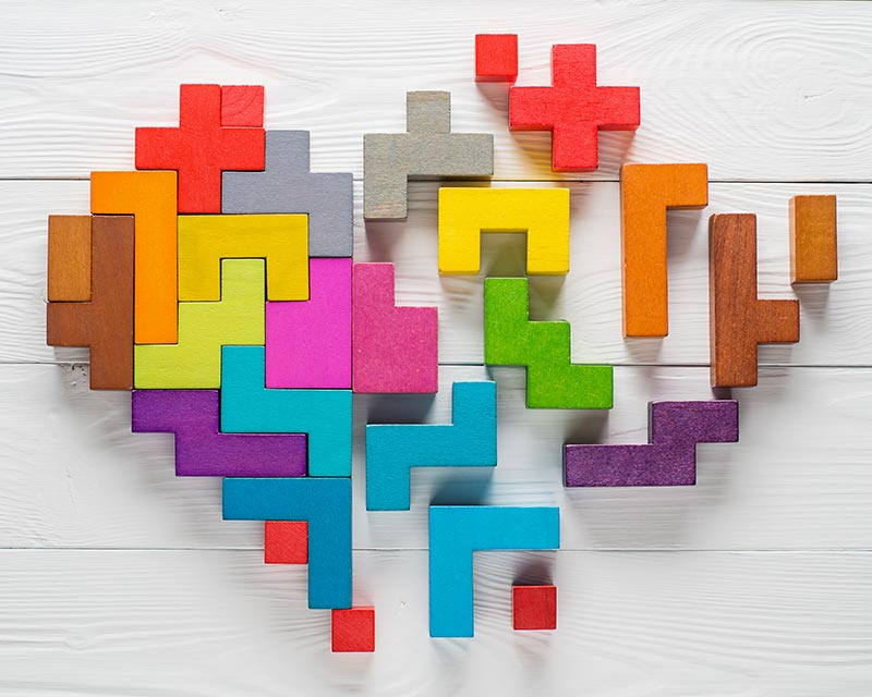 picture of wooden blocks connecting to forming a heart